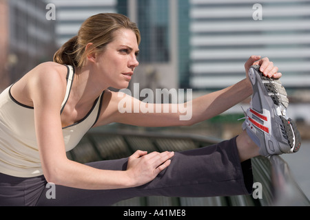 Woman stretching outside - Stock Photo