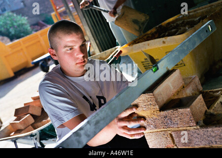 Young bricklayer - Stock Photo