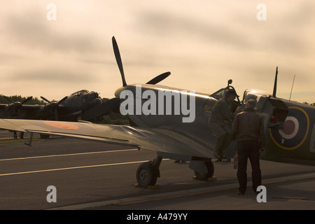 WWII Spitfire with Lancaster Bomber in background Biggin HIll UK - Stock Photo