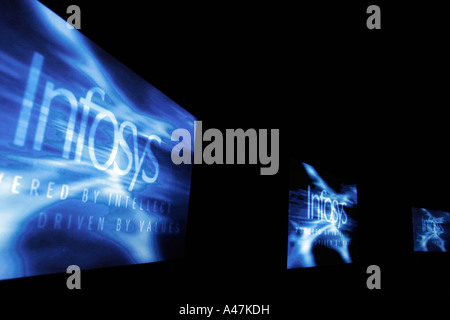 The Infosys logo viewed on multiple screens during a company presentation in Bangalore in India - Stockfoto
