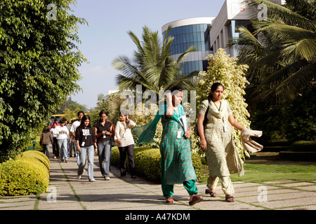 Young Indian women who work in the IT industry wear traditional clothing at the Infosys Campus in Bangalore in India - Stock Photo