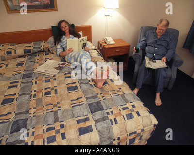 Reading in Bedroom - Stock Photo