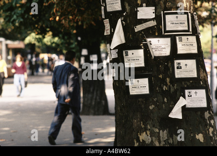 Death notices of those killed in the on-going civil war are pinned to trees on the main street in Banja Luka,  September - Stock Photo