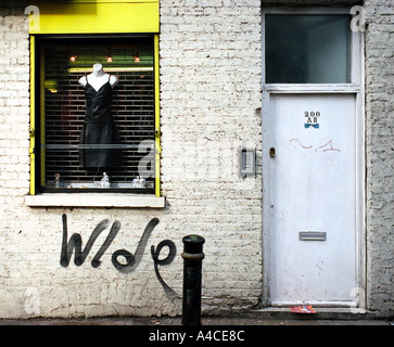 Dress shop window and front door, off Brick Lane in Londons East End - Stock Photo