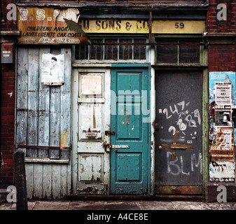 Derelict taylors shop in Londons East End - Stock Photo