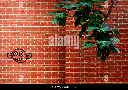 Simple Face wall graffiti near Brick Lane in Londons East End - Stock Photo