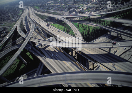 Aerial view of Los Angeles freeways 110 and 105 mixing together like ribbons of cement - Stock Photo