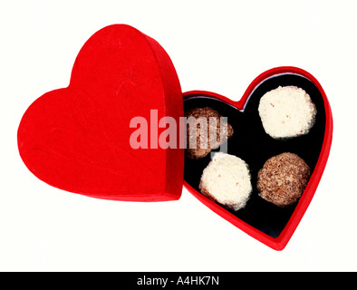 Chocolates in a heart shaped box - Stock Photo