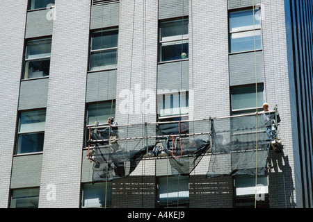 Window cleaning scaffold on side of building - Stock Photo
