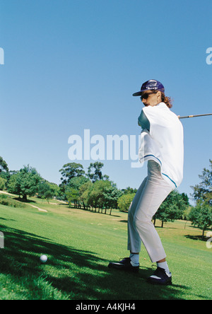 Mature woman playing golf - Stock Photo