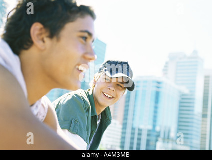Two teenage boys in city setting - Stock Photo