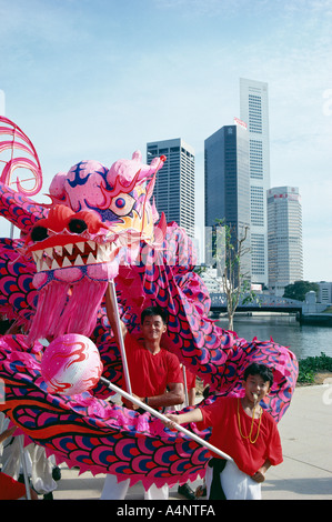 Chinese dragon dancers Singapore National Day Singapore Southeast Asia Asia - Stock Photo