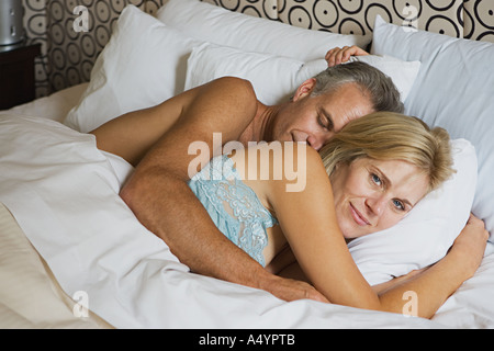 Mature couple in bed - Stock Photo