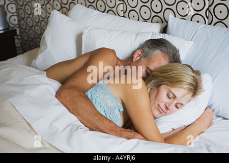 Loving couple sleeping - Stock Photo