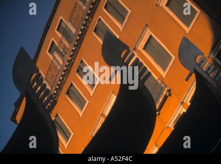 Gondolas reflected in water, Venice, Italy - Stock Photo