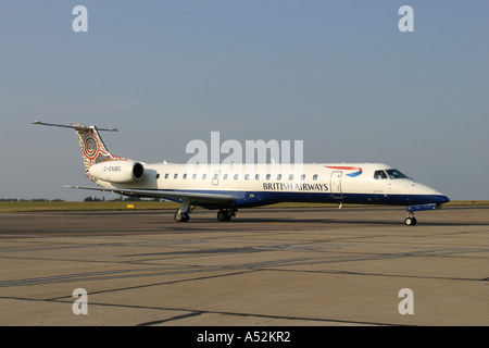 Embraer EMB 145 regional jet commuter aircraft of British Airways - Stock Photo