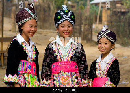 Hmong Girls in Traditional Clothing Ban Khua 1 near Luang Prabang Laos - Stock Photo