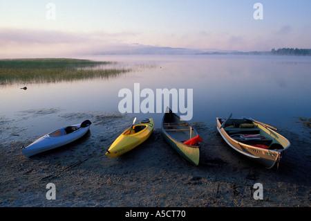 Empty boats on shore of Webb Lake - Stock Photo