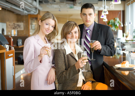 Group of People With Glasses of Champagne Short Depth of Focus On Woman s in the Middle Face - Stock Photo