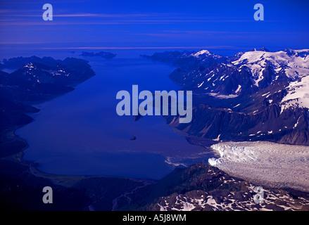Aialik Glacier flows down into Aialik Bay, Kenai Fjords National Park - Stock Photo
