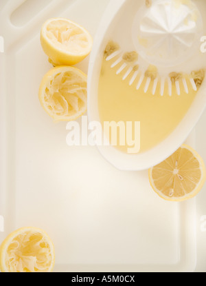 High angle view of oranges and juicer - Stock Photo