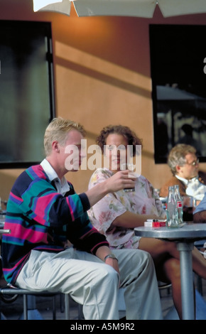 Paris France, Young Tourist Couple, Sharing Drinks, Cafe Terrace in 'Les Halles' Fast Food Restaurant - Stock Photo
