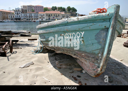 Beached Dorry wooden plank boat - Stock Photo
