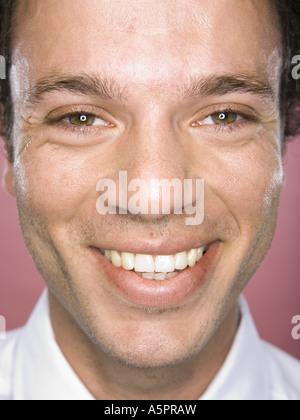 Close-up of a businessman smiling - Stockfoto