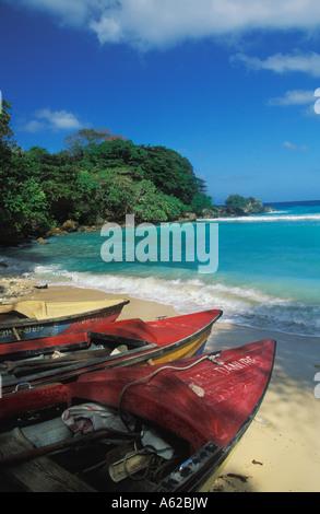 Fishing boats on beach at Boston Bay on  North East Coast of Jamaica - Stock Photo