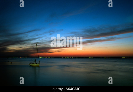PICTURE CREDIT DOUG BLANE Boat ankered in a bay in Queeenstown at sunset New Zealand - Stock Photo