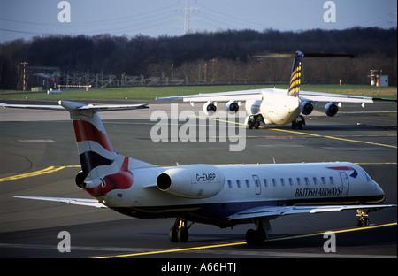British Airways Embraer ERJ-145 passenger airliner at Dusseldorf International Airport, North Rhine Westphalia, - Stock Photo