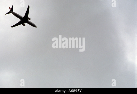Passenger aircraft on final approach to London Stansted airport, Essex, UK. - Stock Photo