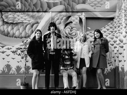 Teenagers standing outside a shop called Granny takes a trip in Kings road London in 1967. - Stock Photo