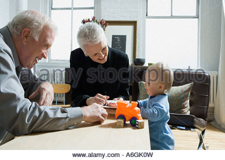 Little boy and grandparents - Stock Photo
