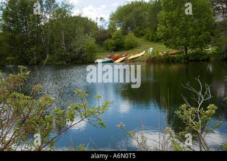 Kayaks at the ready on lake - Stock Photo