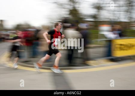 PICTURE CREDIT DOUG BLANE running on a road as part of the Nike Milton Keynes half marathon - Stock Photo