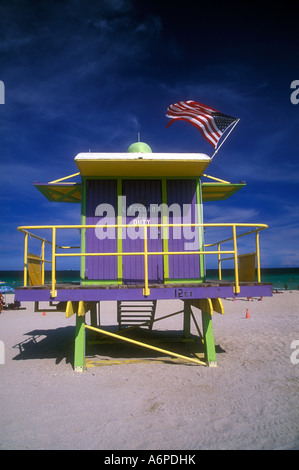 Flag flying over art deco lifeguard station , South Beach - Stock Photo
