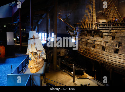 A 3-4 meters long model of the 17th century battleship Vasa (real ship in the background) at the Vasa museum in - Stock Photo