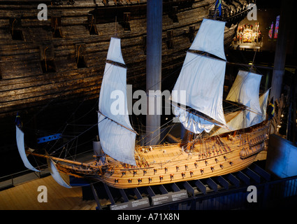 A 3 to 4 meters long model of the 17th century battleship Vasa real ship in the background at the Vasa museum in - Stock Photo