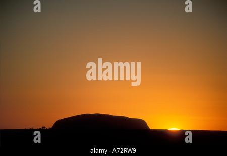 Ayers Rock Uluru at Dawn Northern Territories Australia - Stock Photo