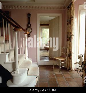 Antique Chair Beside Open Door To Dining Room In Pink