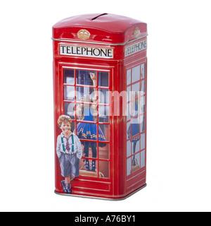 Tin telephone box shaped money box on a pure white background. - Stock Photo