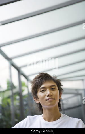 Young man, looking at camera - Stock Photo