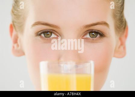 Woman with glass of orange juice - Stock Photo