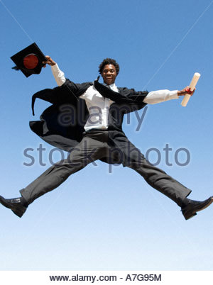 a graduate jumping for joy stock photo royalty free image