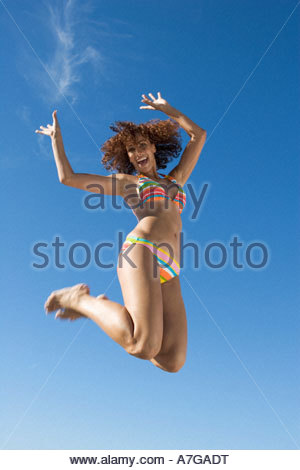 A young woman jumping - Stock Photo