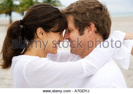 A couple on a beach - Stock Photo