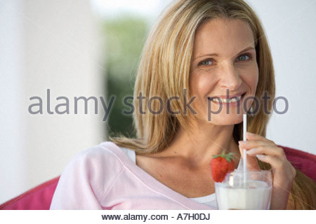 A woman drinking a health drink - Stock Photo