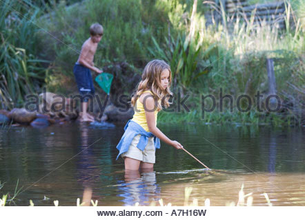 Kids fishing in the river stock photo 33346987 alamy for Kids fishing nets