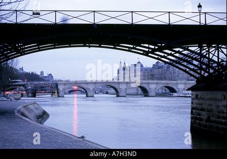 Paris, Ile de la Cite in twilight, Pont des Arts - Stock Photo